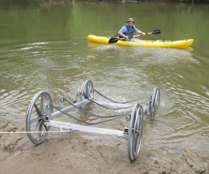 """Speaking of altering our habitat...Wheelchair user and volunteer CRBI Adventure Trip Coordinator disembarks on the Oostanaula with the help of a launching device dubbed the """"Crawford Crawler"""""""