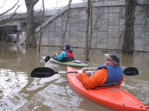 Paddlers ply the Burwell Creek floodplain during high water in January. As much as 80 percent of the proposed Burwell Creek building site was under water during this flood.