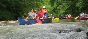 Paddlers shoot through a shoal on Euharlee Creek.