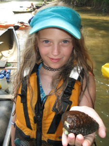 Jessa Goldman of Pisgah Forest, NC shows off a mussel find on the Oostanaula.